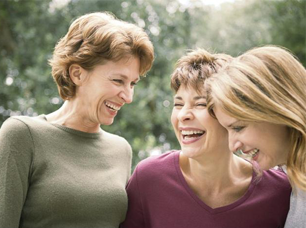 Group of happy women laughing and smiling
